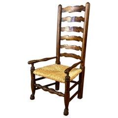 English Georgian Period Elm Ladderback Fireside Armchair with Rush Seat, c. 1800