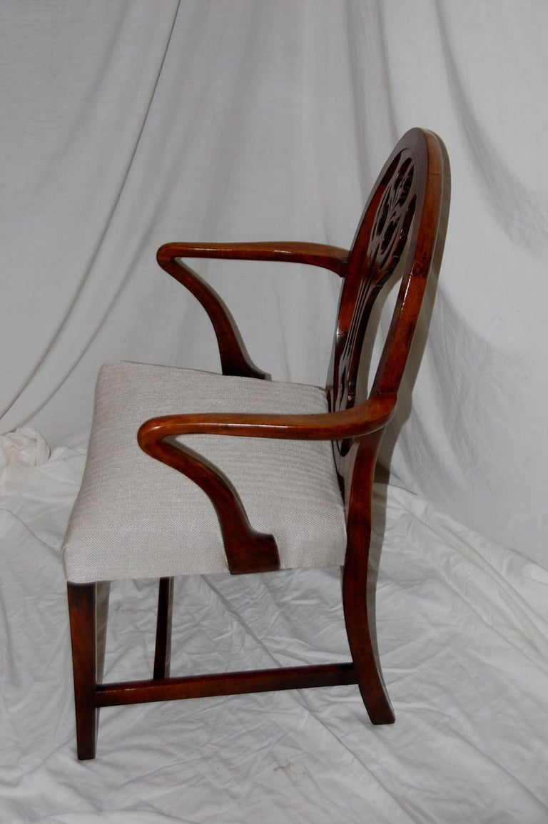 English Georgian Hepplewhite period mahogany armchair with carved splat within an oval back, shepherd's crook arms, tapered legs, saddle seat, circa 1790 $1,885.