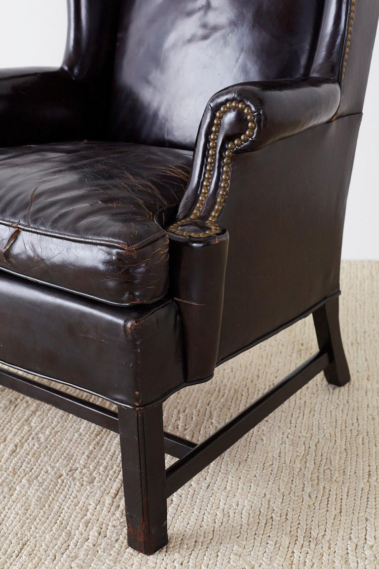 20th Century English Georgian Style Black Leather Wingback Armchair For Sale