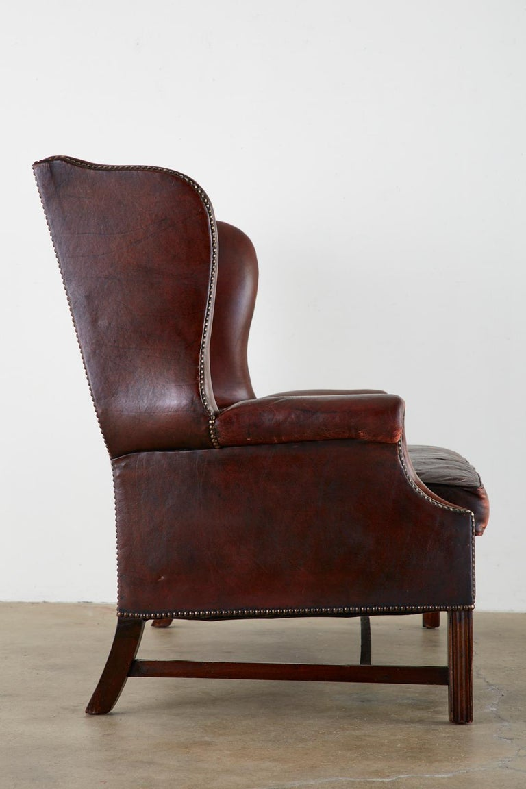 20th Century English Georgian Style Tufted Leather Chesterfield Wingback Settee For Sale