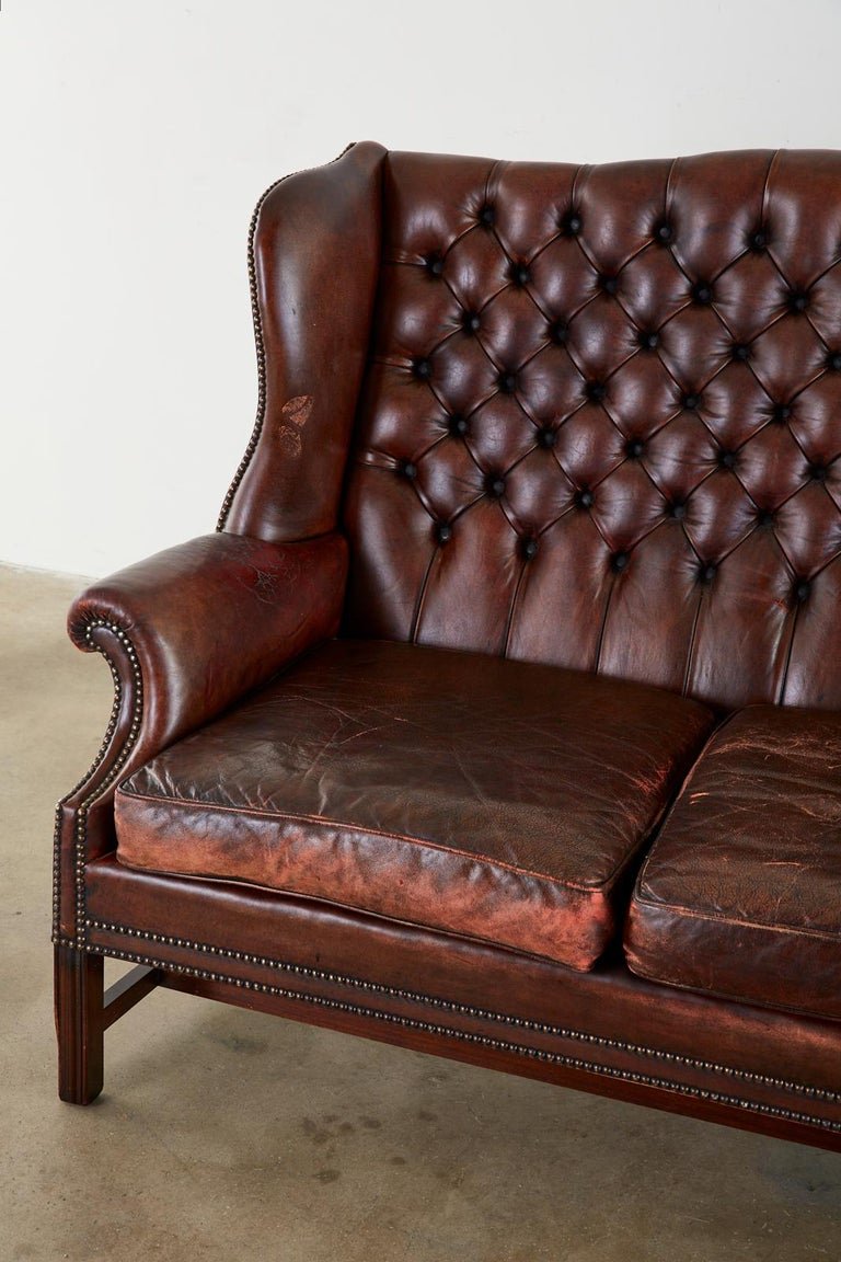 English Georgian Style Tufted Leather Chesterfield Wingback Settee For Sale 1