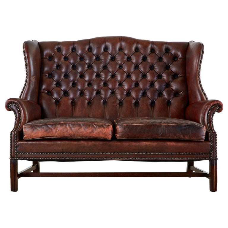 English Georgian Style Tufted Leather Chesterfield Wingback Settee For Sale