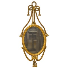 English Georgie III Oval Carved Rope and Tassel Giltwood Mirror, circa 1830