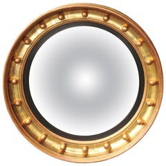 English Gilt and Ebonized Wood Girandole Bull's-Eye Convex Mirror, circa 1870