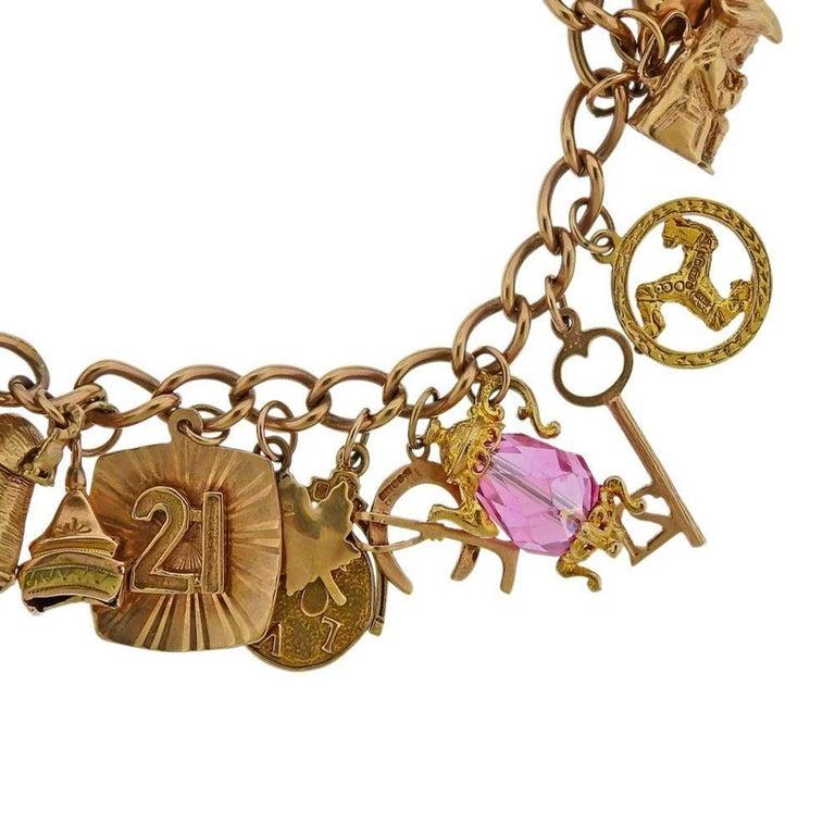 English 9K Gold 3D charm bracelet with gemstones. Measures - 7 1/2