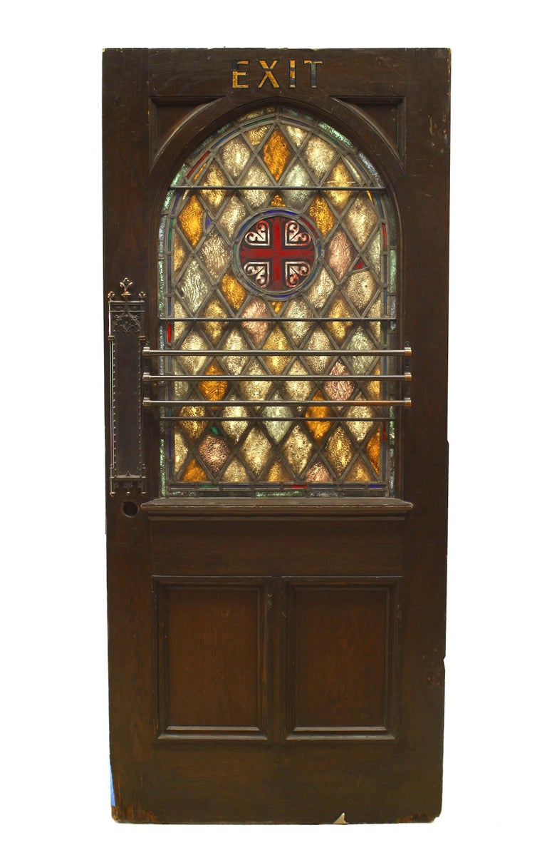 English Gothic style stained oak door with leaded glass panels and diamond design with cross, (19th century).