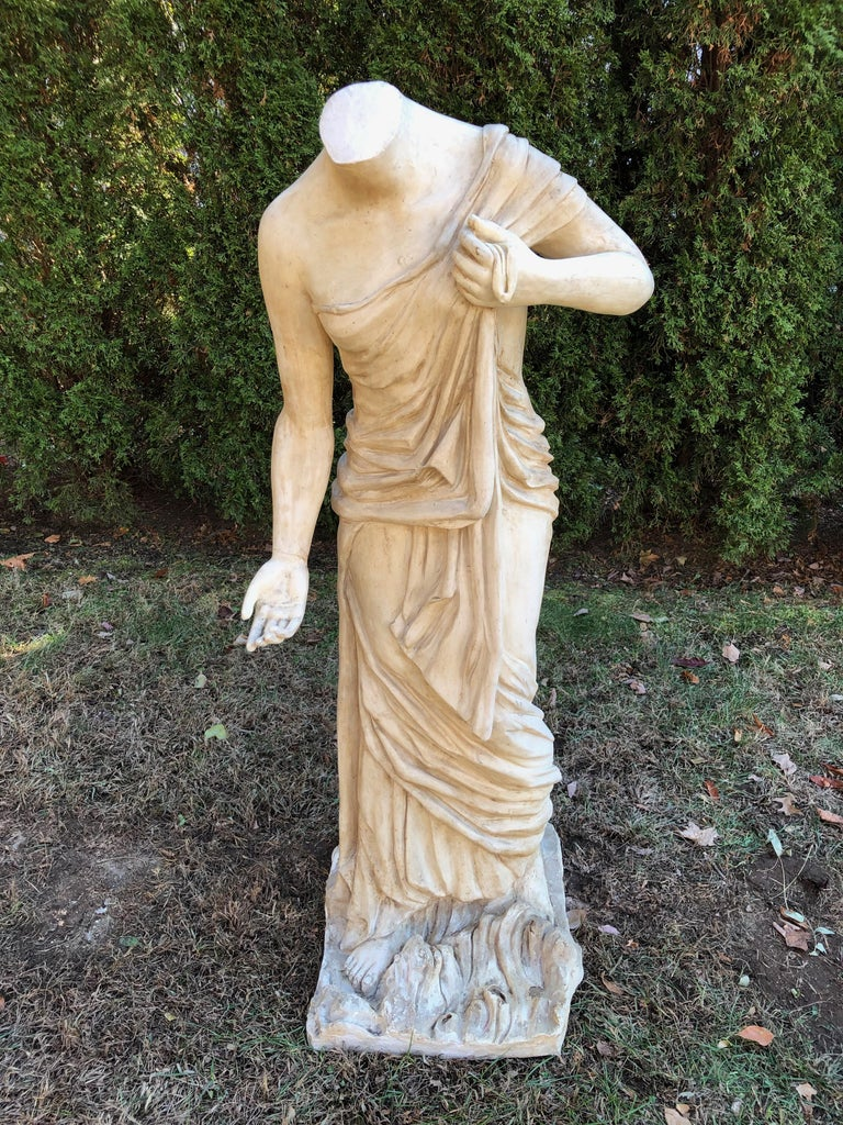 We love all forms of classical statuary, and this unusual piece is fabricated from resin, so she probably was an indoor piece or movie prop originally. Very lightweight, and in overall good vintage condition, there are some losses to the