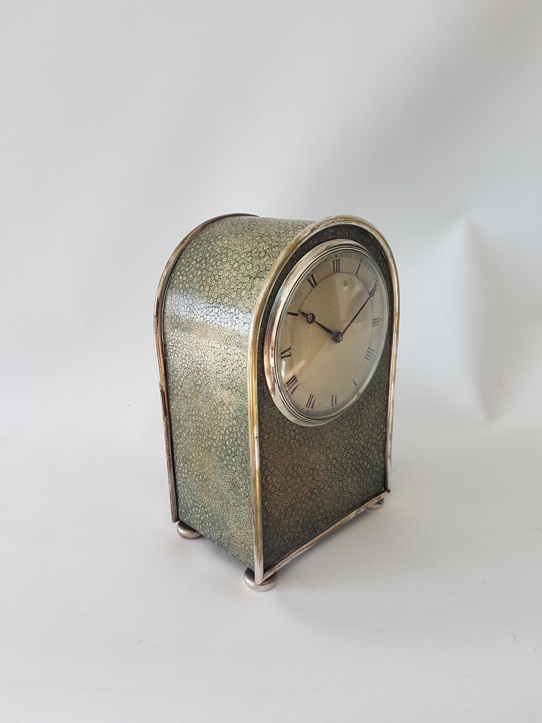 A very fine English late 19th century shagreen & silvered bronze hump backed carriage clock. The nicely proportioned case with fine convex engine turned dial with moon and sitting upon bun feet. The 8 day lever movement numbered. Circa 1895. 7