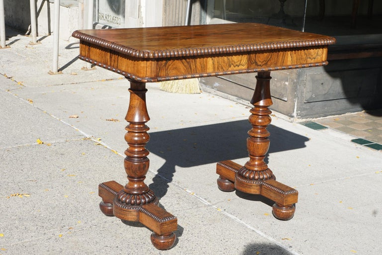 This table retains a fine old faded rosewood finish and bears striking similarities to a Gillows table of 1825 listed in Judith & Martin Millers Antiques Directory of Furniture published in 1995. The legs support entirely turned from the solid