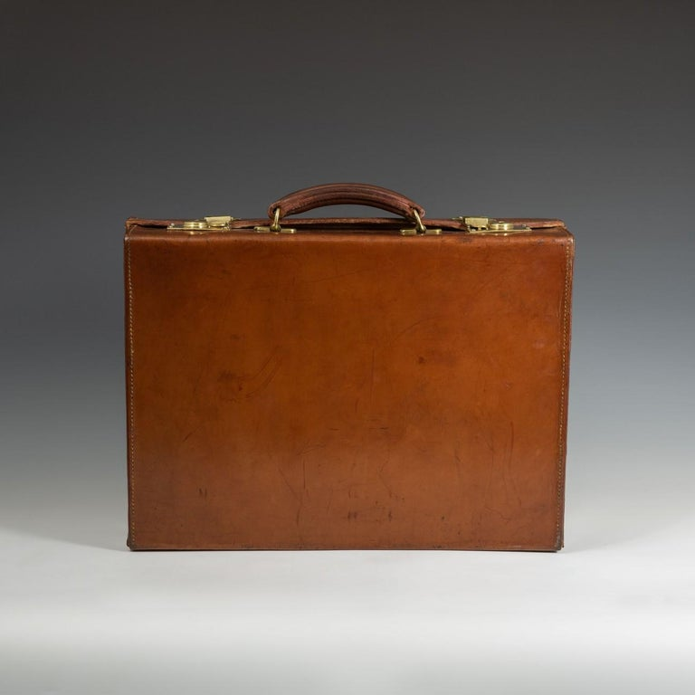 A splendid English leather attaché case with cast brass fittings, circa 1940. The briefcase has a new fabric lining to the interior.  Dimensions: 45.5 cm/17? inches x 34 cm/13? inches x 12.5 cm/4? inches  Bentleys are Members of LAPADA, the London