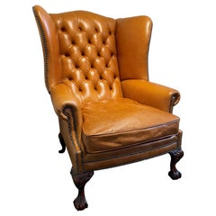English Leather Buttoned Back Wing Armchair