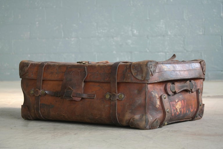 If suitcases could speak and while this fantastic English leather steamer trunk may not speak it does tell quite a story of splendid travel and adventure and the feat of surviving it all including two world wars. Made circa 1883 by legendary John