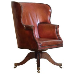 English Mahogany and Leather Upholstered Swivel Wing Chair