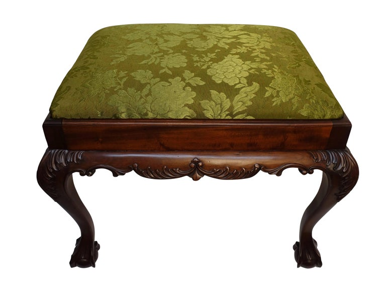 Chippendale style mahogany bench or stool with claw and ball feet, and having carved acanthus leaf carvings on the knees, England, first half of the 20th century.
