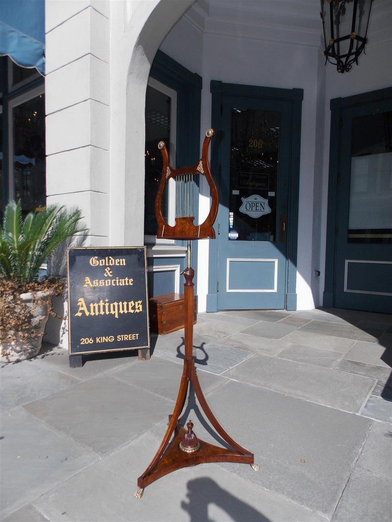 English mahogany bronze mounted lyre music stand with intertwined floral and musical satinwood inlays, adjustable music rest and telescopic brass cylinder, bulbous ringed reverse tapered hexagonal standard, and terminating on out swept tapered legs