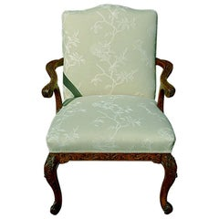 English Mid-19th Century Gainsborough Carved Lounging Chair with Cabriole Legs