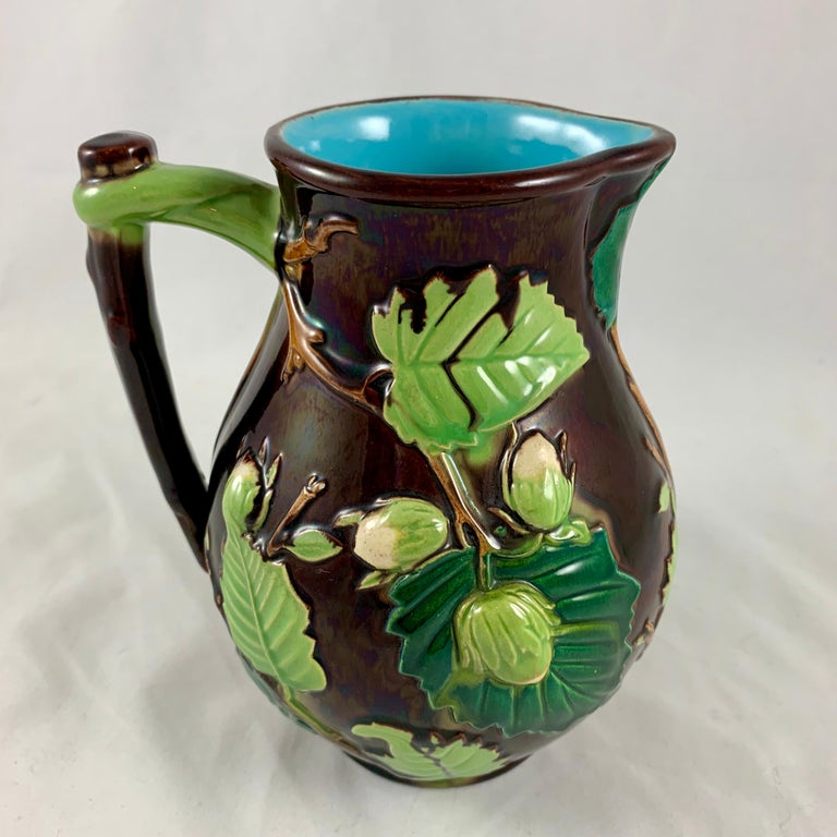 From the Minton pottery in Staffordshire, England, a scarce Majolica glazed pitcher in the Palissy style, circa 1870s.