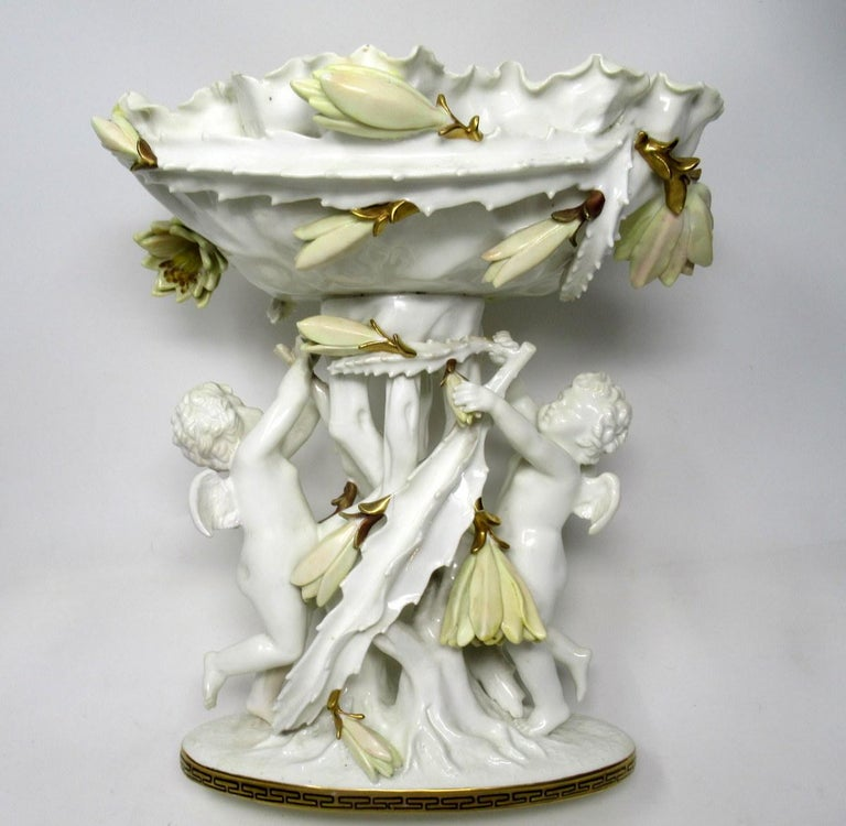 A very impressive example of an English Moore Brothers porcelain centerpiece of outstanding quality and generous proportions.   Last quarter of the 19th century.  This rare and unusual tall form Centerpiece depicting flowering Cacti, with a pair