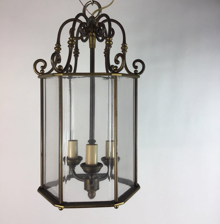 1-3056 English nautical patented brass hexagonal lantern. Three 40 W candelabra base bulbs. Newly rewired.