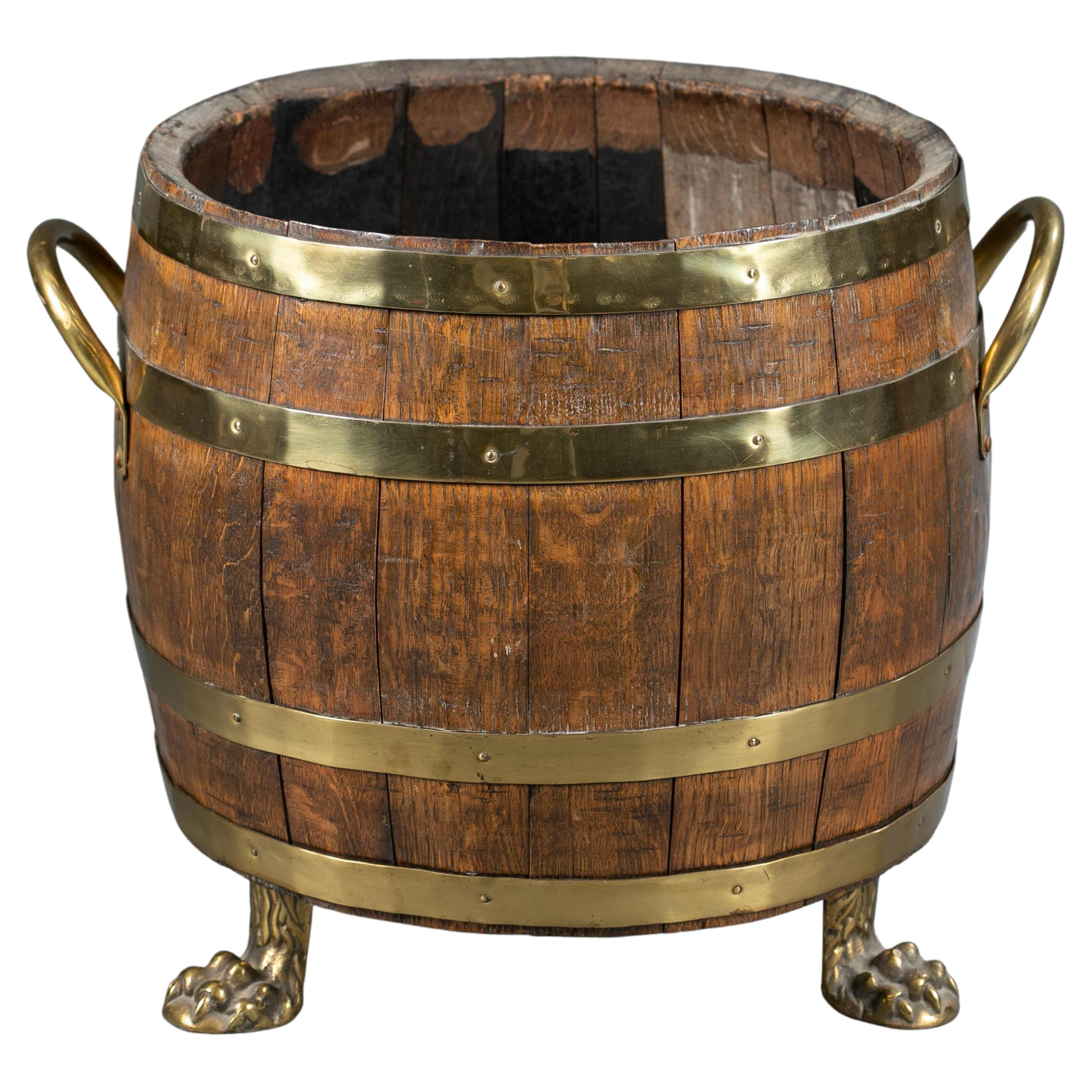 English Oak and Brass Barrel Shaped Cellarette with Paw Feet