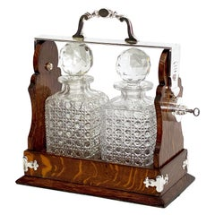 English Oak and Silver Tantalus or Decanter Drinks Set by Betjemann's