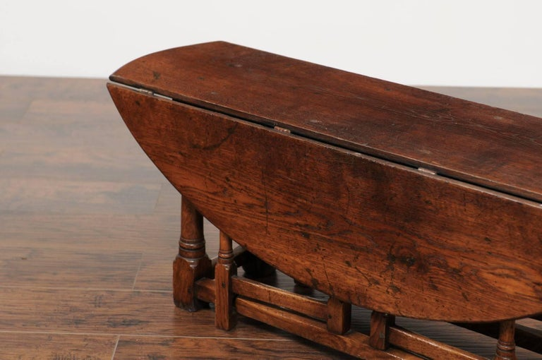 English Oak Drop Leaf Oval Top Coffee Table With Double