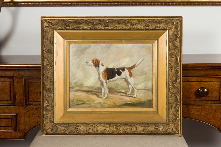 An English oil on board dog painting from the mid-20th century, depicting a hound in a landscape. Titled