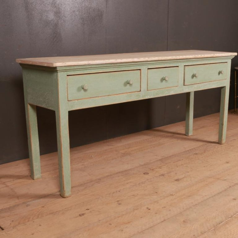 Early 19th century English painted dresser base with a pale scrubbed pine top, 1820