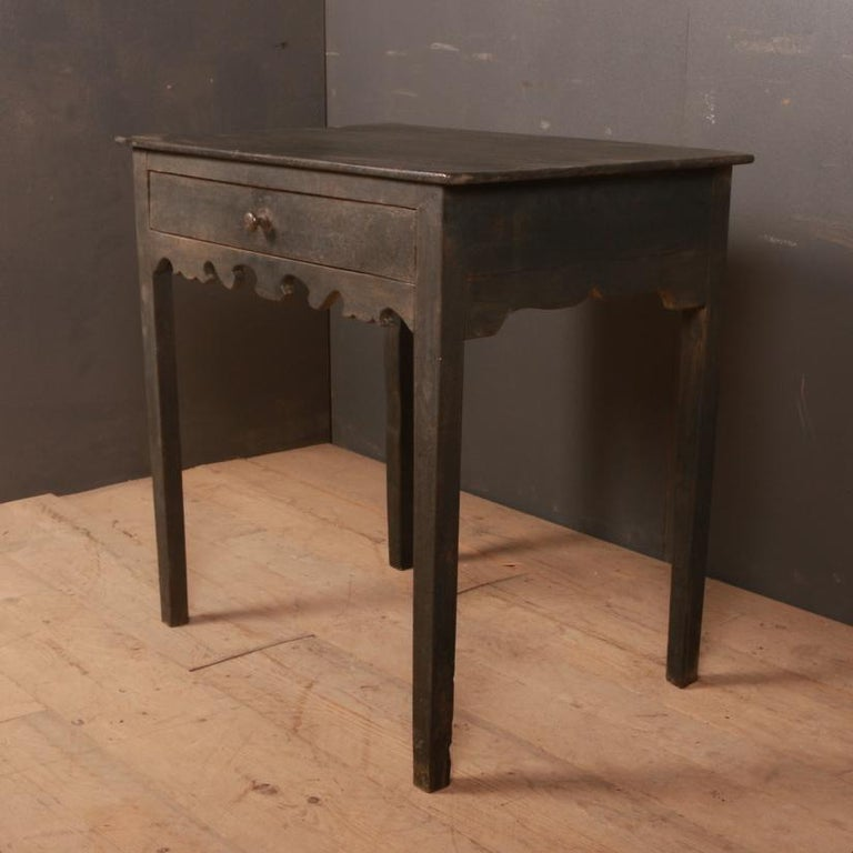 Early 19th century English painted side table. 1810.  Dimensions: 30 inches (76 cms) wide 20 inches (51 cms) deep 29.5 inches (75 cms) high.