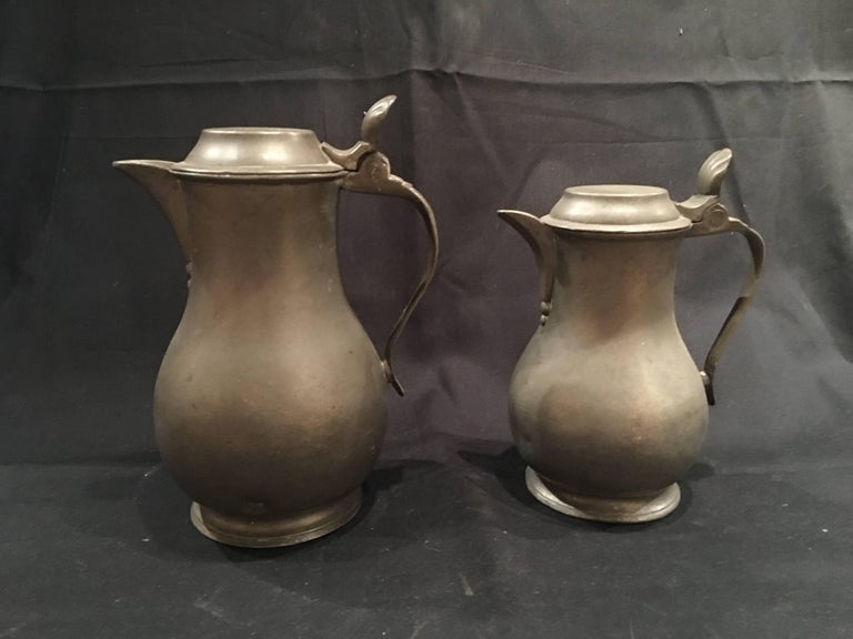 English pair of lidded Pewter jugs or tankards with handles, 19th century.