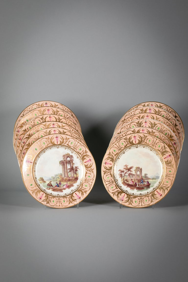 Each with figural and animal painting within landscapes, each identified location on the verso consisting of 25 pieces: Compote, pair of covered sauce tureens and stands, 2 scalloped dishes, 2 shell dishes, 4 lozenge dishes, 14 plates.