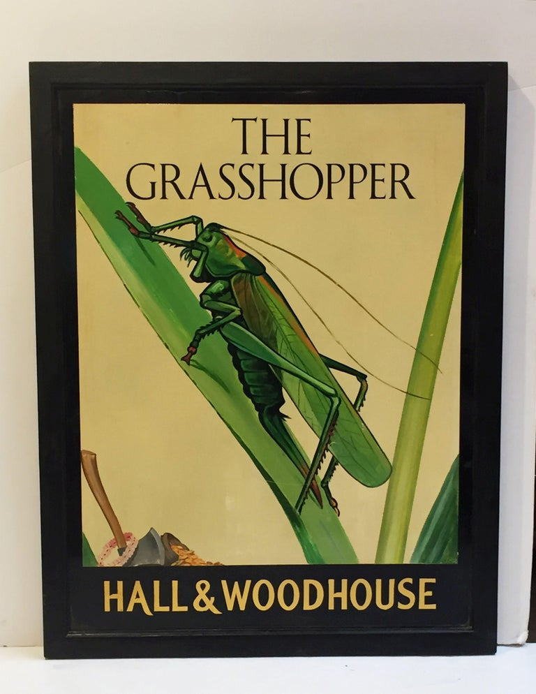 An authentic English pub sign (one-sided) featuring a painting of a grasshopper on a blade of grass, entitled: The Grasshopper  Marked: Hall & Woodhouse  Hall and Woodhouse is a British regional brewery founded in 1777 by Charles Hall in