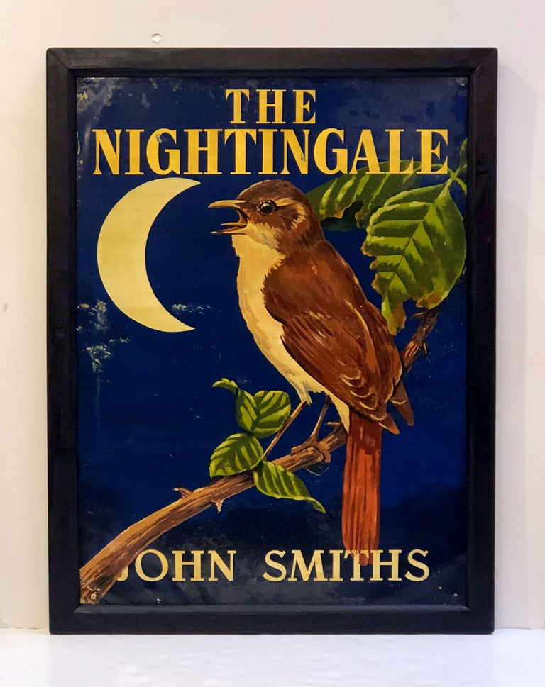 An authentic English pub sign (one-sided) featuring a painting of a singing nightingale bird perched on a leafy branch, against a dark blue background with a crescent moon, entitled: The Nightingale