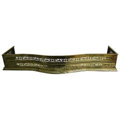 English Regency Brass Serpentine Fender with Leaf and Cast Brass Decoration