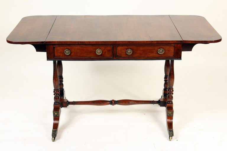 English regency rose wood sofa table, circa 1810. The width is 52.25