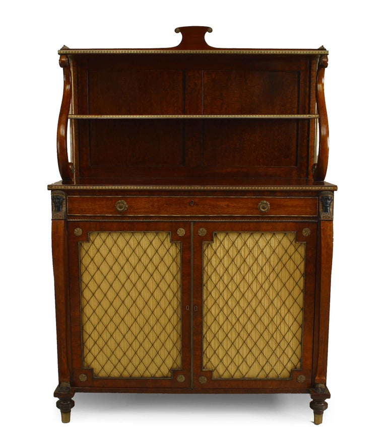 English Regency rosewood secretaire cabinet with two upper shelves supported by a lyre form over a secretaire drawer fitted with a leather writing surface above a pair of grill doors.