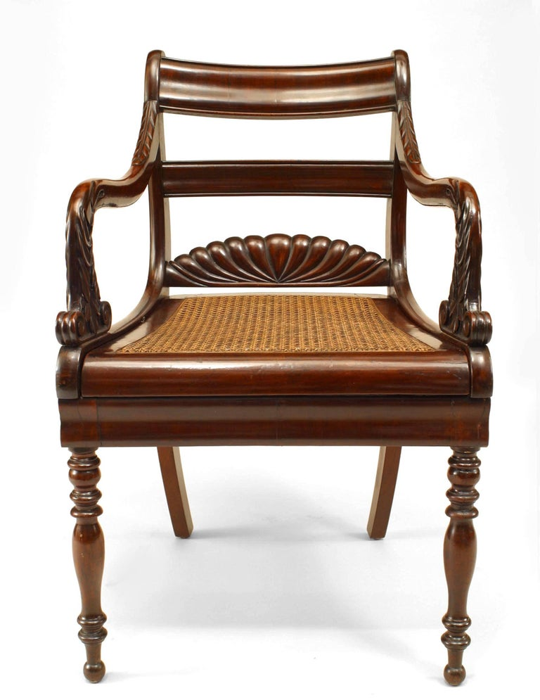 English Regency style (19th century) carved mahogany ladder back armchair with cane seat and fluted fan design back.