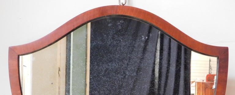 Early 20th Century English Regency Style Shield Shape Mahogany Mirror For Sale