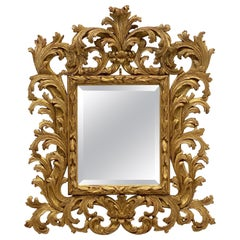 English Rococo Beveled Mirror with Carved Giltwood Frame