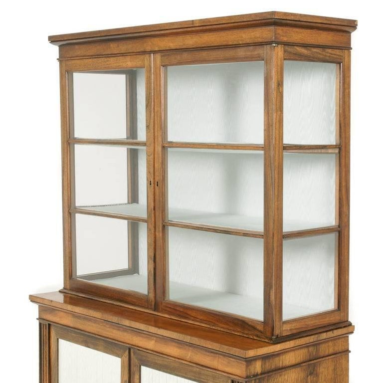 A lovely quality English William IV rosewood china cabinet, the lower section with two doors with pleated silk, the upper section featuring glass sides and doors for display, circa 1835.