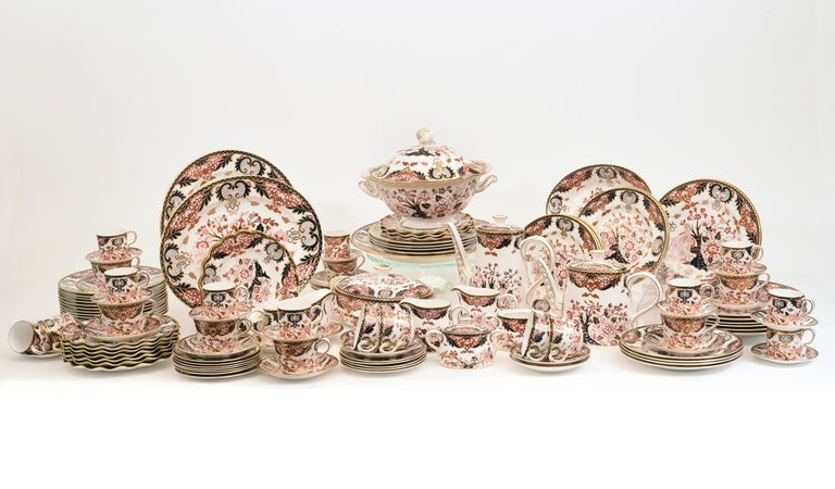English Royal crown derby complete dinnerware service including tea and coffee service for twelve people with serving pieces. Every piece is in excellent condition. Maker's mark undersigned. All together 117 pieces. 12 dinner plates 12 lunch plates