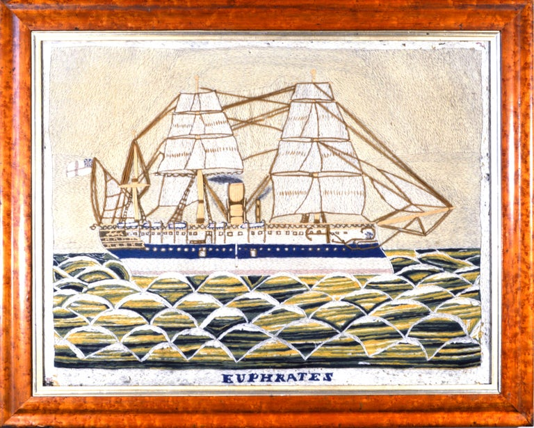 The large sailor's woolie or woolwork in a maple frame depicts a starboard view of the HMS Euphrates sailing on a rough sea, the wool naively made with large looping waves, the crests of waves in white and the rough sea in yellow and green. 