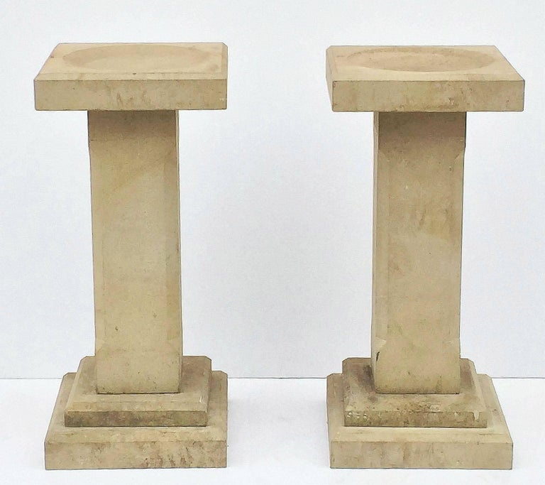 A pair of fine English garden bird baths of sandstone, each featuring a square top with round recessed bath area in the centre, set upon a chamfered column pedestal with square plinth base.  Dimensions:  H 33 1/4
