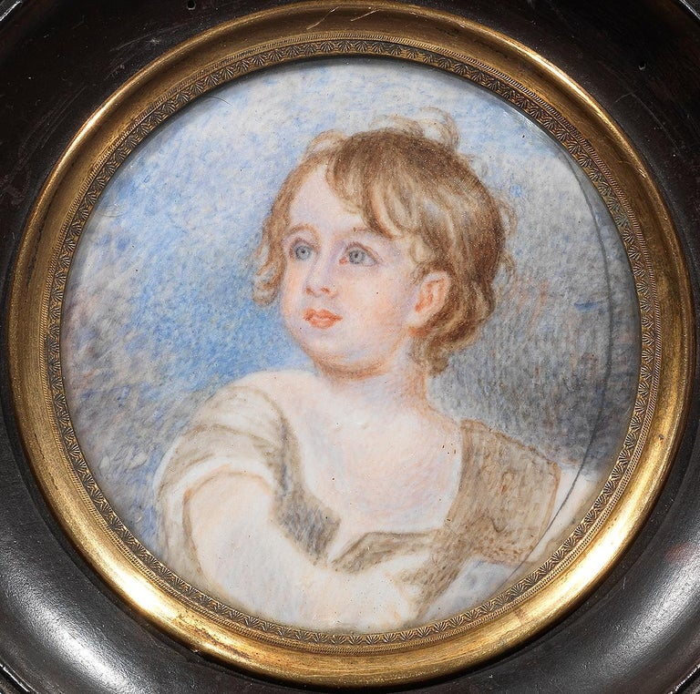 A miniature portrait of a young boy in beige coat and white frilled shirt round 90mm.