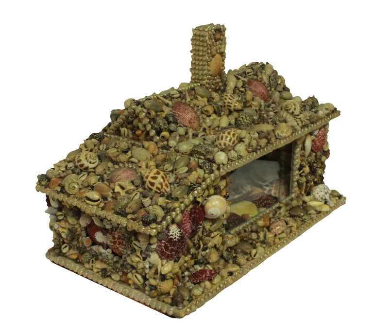 An English shell grotto modelled on a cottage, with doors and a glazed window with mirror interior. Nicely worked throughout with no losses.