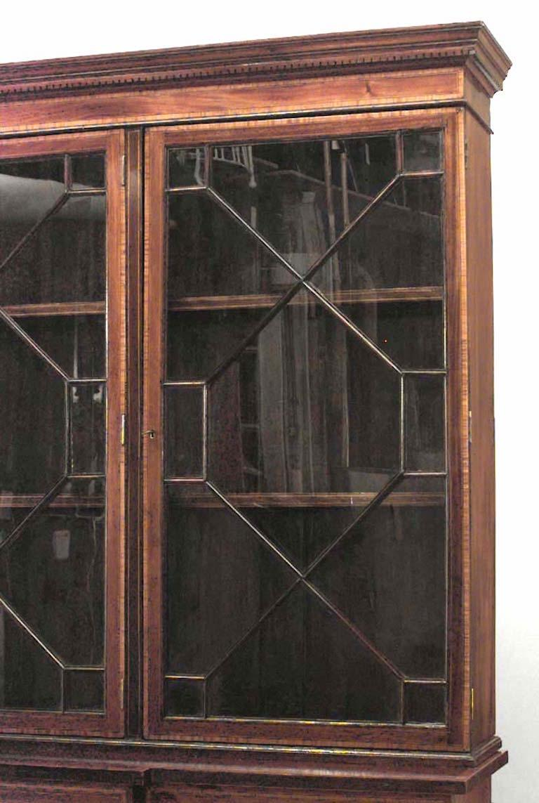 English Sheraton style (18th-19th century) mahogany & satinwood inlaid breakfront cabinet with 3 doors at bottom and 3 lattice glass doors on top section.
