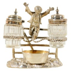 English Silver Plated Cruet Set of Young Boy Leaping in the Air, circa 1873