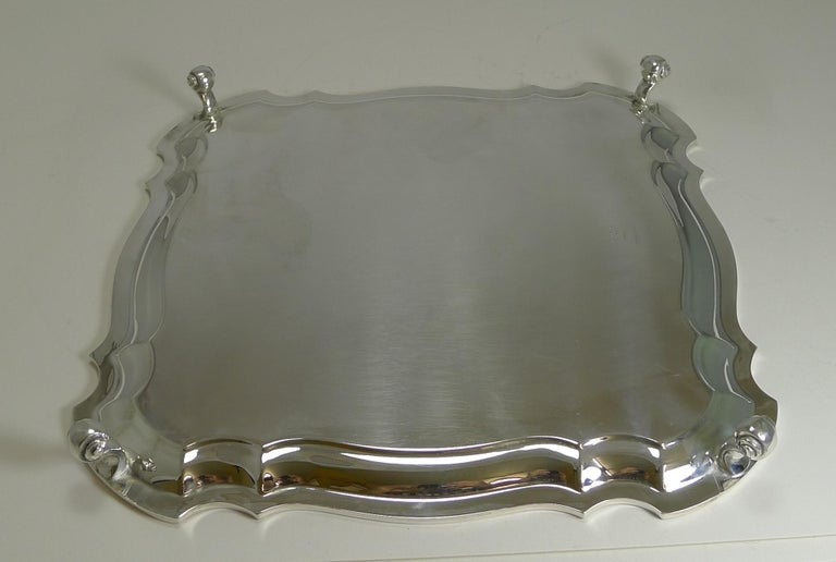 A fabulous square salver or tray with a wonderfully shaped border and standing on four attractive scrolled legs.  The underside is fully marked for C W Fletcher and Sons Ltd; it is also marked with the trade mark
