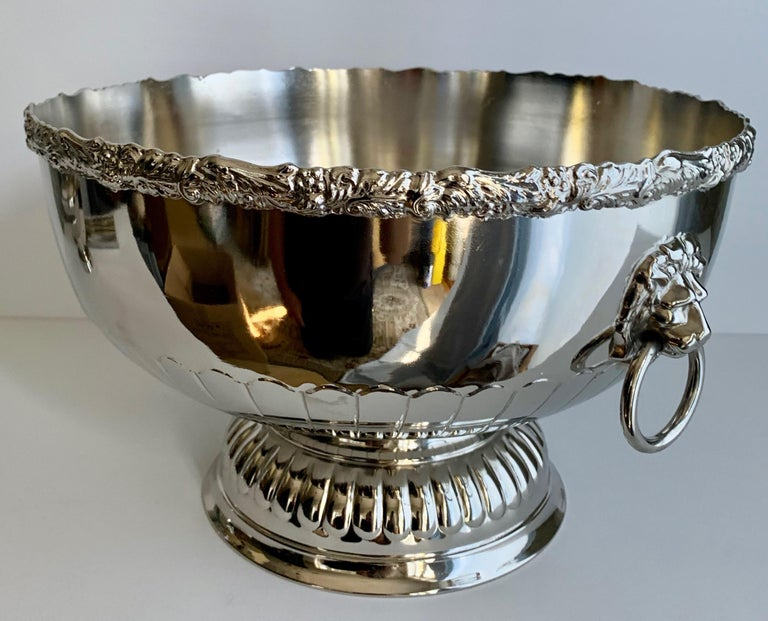 English silver punch bowl with rim and lion handle details - freshly plated punch bowl, silver over copper, made in England. Stamped on Bottom.  A handsome bowl for punch, cooling Champagne or a wonderful holder for flowers or fruit on any table -