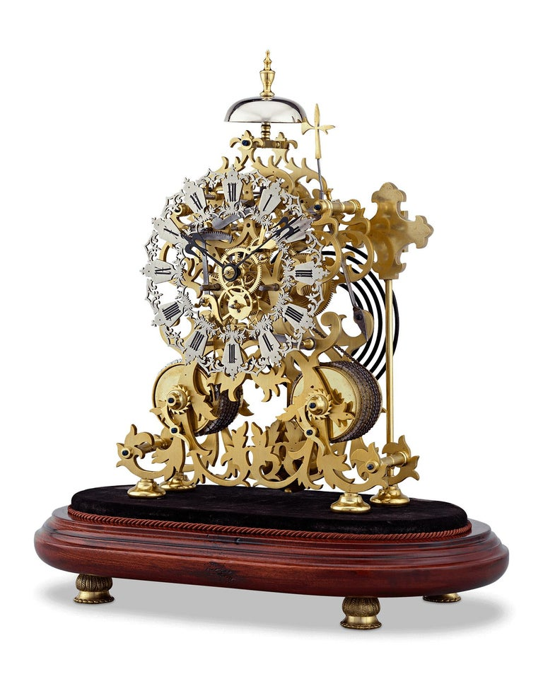 This exceptional two-train English skeleton clock was crafted by the celebrated clockmakers J. Smith & Sons of Clerkenwell. The beautifully designed floral scroll frame incorporates an ivy motif, which perfectly complements the Gothic-style pierced